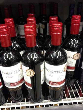 CopenhagenDenmark 13th September   2015_  Red wine bottles on shelf in grocery store Editorial