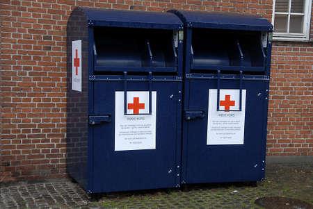 rood kruis: Kastrup.Copenhagen.Denmark  20th  September  2015  _Red cross oldcloths donation conatiners