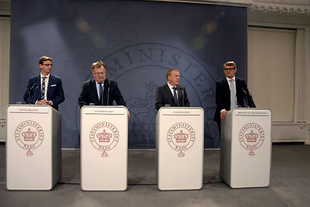 minister: CopenhagenDenmark 01 October   2015_ Lars Lokke Rasmussen holds joint press conference his three cabnit minister Claus Hjort Frederiksen minister for finance , Karten Lauritzen miniter for taxation and revune  and Troel Lund Poulsen minister fir busines