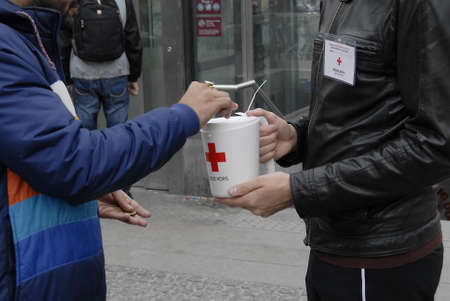 thier: CopenhagenDenmark 04 October   2015_  Danes valunteers collecting donation for Red Cross  thier work on foreign souls