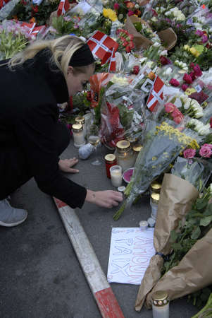 attacked: CopenhagenDenmark _ 15th November  2015 _French flag at half mast at french Embassy in Copenhagen and Danish police presentspeople laying lofwers vigils and messages in various language at Frenc Embass in Copenhagen  due tp Paris Terrorist attacked  Fra Editorial