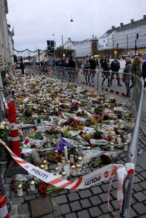 autos: CopenhagenDenmark _ 21th November  2015  _People come and reas messages and lay flwoers take photograph at site in front of french emabssy in Copenhagen pay respect to Paris Atacked victims Editorial