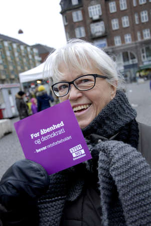 political party: CopenhagenDenmark _ 21th November  2015 _Female promoting No vote or Nej in eu referendum on 03-11-2015 from left political party enhedslisten Editorial