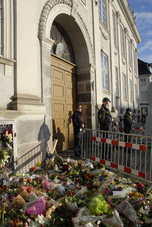 attacked: CopenhagenDenmark _ 26th November  2015  _Police presents at French embassy after Paris terrorist attacked  people lay flowers and come visit french embassy in Copenhagen, Denmark Editorial
