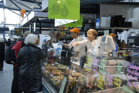 fish shop: CopenhagenDenmark _ 11 March  2016_Shoppers shopping at  Fish shop in Norreporthalen