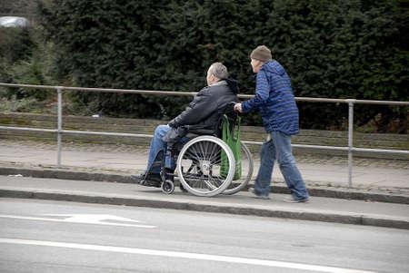 Copenhagen Kastrup.Denmark 11 March  2016-Eldlery male pushing weheel chair