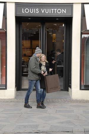 vuitton: CopenhagenDenmark _ 11 March  2016_   Travelers pass by Louis Vuitton on stroeget