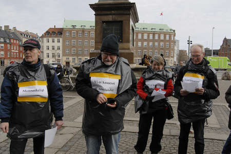 reducing: CopenhagenDenmark _ 15 March  2016_Danes protest agaanist state reducing cash benefit and debating in danish parliament to pass law to reduce cash benefit from some people those live with exstra cash benefit