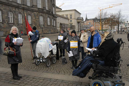 debating: CopenhagenDenmark _ 15 March  2016_Danes protest agaanist state reducing cash benefit and debating in danish parliament to pass law to reduce cash benefit from some people those live with exstra cash benefit