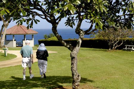 vacationers: KAUAI ISLAND  HAWAII USA _ Mainland  vacationers walking and enjoying ocean view at Theclift resort at princeville north Kauai island  11 Jan 2013