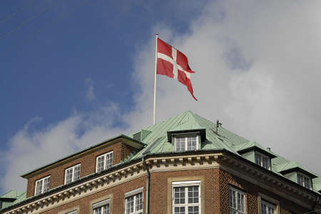 ministry: CopenhagenDenmark _ 24 March  2016_Danish defence ministry and dannebrog danish fkag fly over ministry
