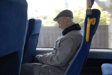 CopenhagenDenmark _ 24 March  2016_ Senior male napping in bus during journey Editorial