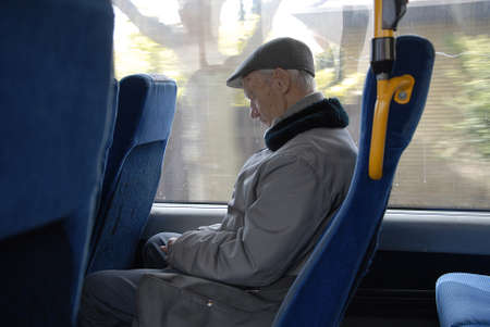 eldlery: CopenhagenDenmark _ 24 March  2016_ Senior male napping in bus during journey Editorial