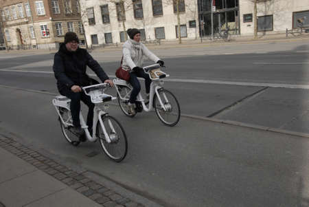 easter sunday: CopenhagenDenmark _ 27 March  2016_ Touists use citybike on easter sunday