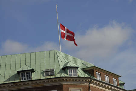 nazi flag: COPENHAGEN  DENMARK_ 09 April 2016 _  Today dannebrog in other danish flag is at half mast on all government qnd public building and danish parliament christians in the memories of black day in danish history Nazi germany occuption on 9 april 1940 durign Editorial