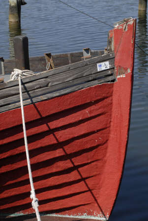 old boat: Copenhagen Kastrup.Denmark 13  May  2016.Red colour old boat at Kastrup habour Stock Photo