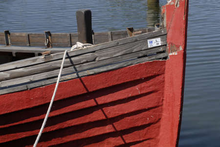 habour: Copenhagen Kastrup.Denmark 13  May  2016.Red colour old boat at Kastrup habour Stock Photo