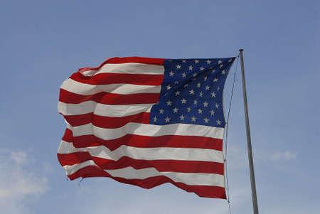 unites: Ellansburg wshington USA- 20 May 2016_  USA stars and stripes flag flys ovr Perkins restaurant and Bakry in Ellensburg, Washington ,USA