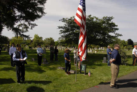 lewiston: Lewiston Idaho USA- 30 May 2016_  Memorial day  ceremony and people put flowers on their love ones on memorial day celebration at Normal Hill Cemetery in Lewiston, Idaho, Uinted States of Ameria today on monday memorial day naational holiday       . Editorial