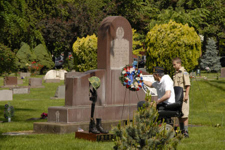 lewiston: Lewiston Idaho USA- 30 May 2016_  Memorial day  ceremony and people put flowers on their love ones on memorial day celebration at Normal Hill Cemetery in Lewiston, Idaho, Uinted States of Ameria today on monday memorial day naational holiday        .