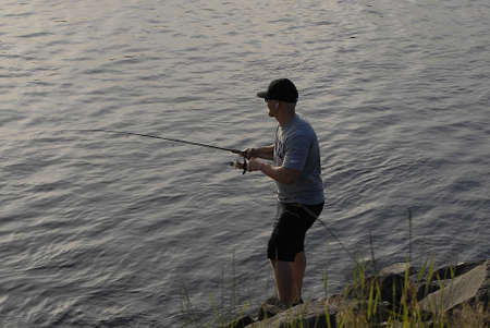 Lewiston Idaho USA- 31 May 2016_Lewiston male catches fish in Snake river in temperature  100 degree fahrentheit  over looking Clarkston Washington                _