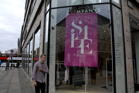 hm: Copenhagen  Denmark. 30 June 2016_ Travelers and shoppers walk sommer and season sale in Copenhagen Denamrk Editorial