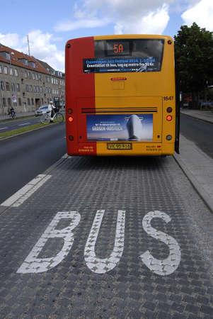 danmark: Kastrup Copenhagen Denmark. 04 July 2016_ transporting baby Danish public transportation system woman woman transport baby prame and bus  lane in Copenhagen, Denmark  .