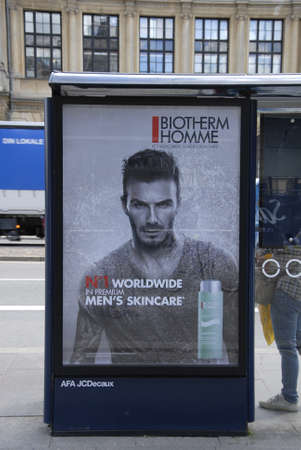 tourists stop: Copenhagen  Denmark. 04 July 2016_Billboard with David Robert Joseph Beckham add for No.1 worldwide in premium men,s skineare at bus stop in Copenhagen Denmark