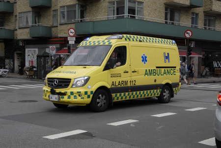 bil: Copenhagen  Denmark. 06 July 2016_ Minor hppening  and Danish police (politi bil) and medical doctor ambulance in action on christianhavn torv in Copenhagen, Denmark Editorial
