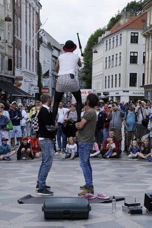 entertainer: Copenhagen  Denmark. 08 July 2016: Street female entertainer on stroeget on amager torv .