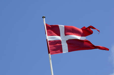 Copenhagen_Denmark_  13 July 2016-Danneborg_danish flag fly over danish ministry of defence