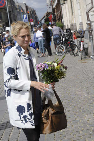 radical: Copenhagen_Denmark_  15 July 2016-Ms.Zania Stampe danish female politician fromdanish radical libery party pays tribute to French victims laying flowers at French Embassy in Copenhagen Denmark among other dane pat ribune to france and french flag is at ha Editorial