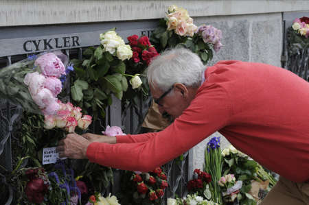 attacked: Copenhagen_Denmark_  16 July 2016-European union and French flags at half mast at french embassy and people are puring with flowers to pay tribute and stand solidatry with Frnech victims dies in terrorist attacked in Nice France on French national day on  Editorial