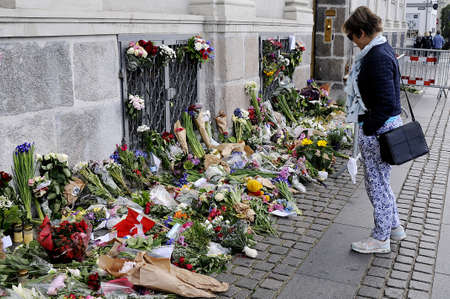 attacked: Copenhagen_Denmark_  17 July 2016-European union and French flags at half mast at french embassy and people are puring with flowers to pay tribute and stand solidatry with Frnech victims dies in terrorist attacked in Nice France on French national day on  Editorial