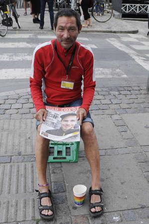 demolished house: Copenhagen_Denmark_  27 July 2016-Homeless male selling homeless magazine hus forbi house is demolished at christianshavn torv     .