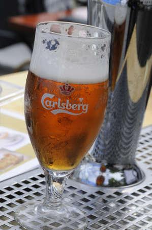 Copenhagen_Denmark_  06 August  2016-  Glas of Carlsberg beer