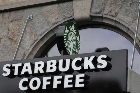 starbucks coffee: Copenhagen_Denmark_  06 August  2016- Consumer drinkging starbucks coffee in Copenhagen Denmark     Editorial