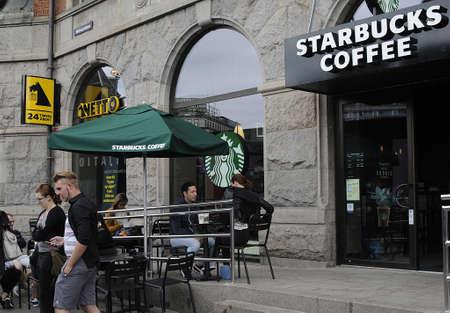 starbucks coffee: Copenhagen_Denmark_  06 August  2016- Consumer drinkging starbucks coffee in Copenhagen Denmark
