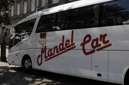 Copenhagen_Denmark_  10 August  2016-Tourits bus from Belgium  Mandel ear  izegem parked at infron of danish aprliamenet