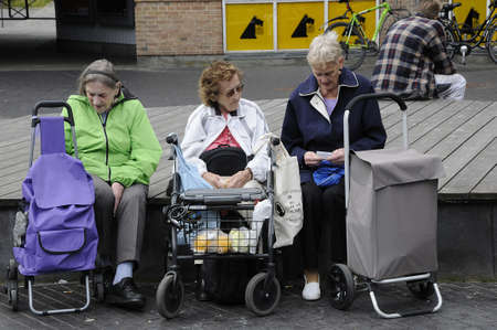 eldlery: 19 August  2016-Danish sneior retired women take rest  and chat after shopping at newly built area in    KastrupCopenhagen  Denmark  Editorial