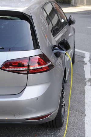vw: 31 August  2016-  Electric  VW Volkswegan  parked at recharge booth    in Copenhagen  Denmark