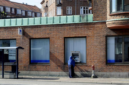 automat: 31 August  2016-People at atm and various danish bank, Banknordik, Nordea        in Copenhagen  Denmark