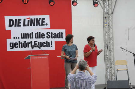 alexandra: 16 September  2016- Ms.Corola Blumhm other die linke politicians holds election rally at Alexandra platz Berlin local elections are on this comming sunday ,Die Linke prty supporters with die linke  bageages and banner and german police stand by for german