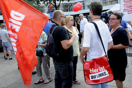 local election: 16 September  2016- Ms.Corola Blumhm other die linke politicians holds election rally at Alexandra platz Berlin local elections are on this comming sunday ,Die Linke prty supporters with die linke  bageages and banner and german police stand by for german