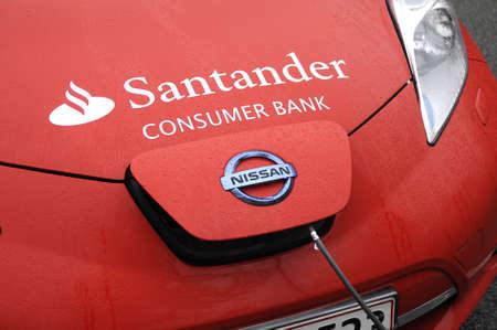 santander: 19 October 2016_ Copenhagen_Denmark. Electric vehicle  japanese trade mark Nissan car and battery rechange E-on booth  and Sandtaner consumer bank