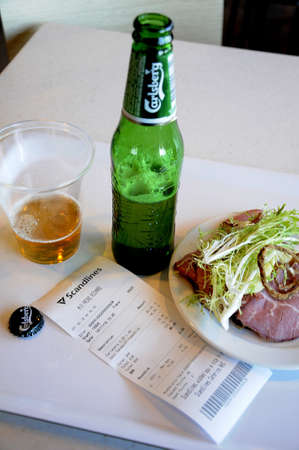 Rodby Denmark_ 12th. November 2016 _Open sandwich roasbeef and bottle of Carlsbeg beer on scndlines fery cross between Rodby Denmark to Puttgarden Germany Editorial