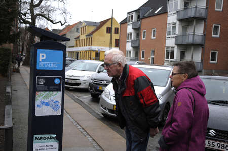 parking ticket: Copenhagen  Denmark_  01.st.December  2016 -Danish senior have hard time to get parking ticket by electroican parking machine via VISA or bank credit card.