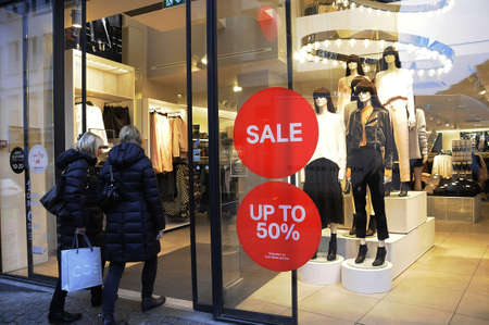 chrstmas: Copenhagen  Denmark_  20th.December 2016 -  Chrstmas shopprs and sale at H&M store and police appearance on streoget pedestrain street in danish capital.