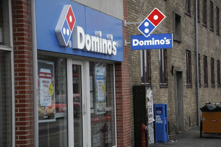 food chain: Kastrup_ Copenhagen_Denmark _ 20th December  2016_ American fast food chain Dominos . Editorial