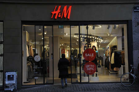 Copenhagen  Denmark_  20th.December 2016 -  Chrstmas shopprs and sale at H&M store and police appearance on streoget pedestrain street in danish capital.